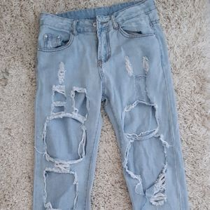 Super Distressed Faded Blue Jeans